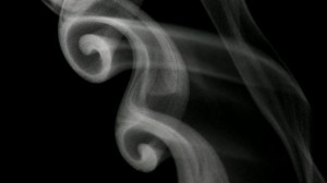swirls of smoke in a moving spiral pattern
