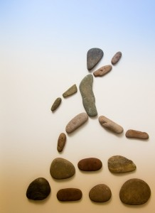 Pebble design of person running to use for divination