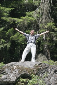 Marge Hulburt standing on top a a large rock