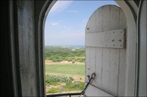 looking out the open door of a windmill