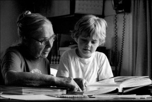 grandmother and child reading a book together