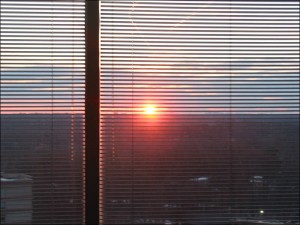 Looking at a sunset through window blinds