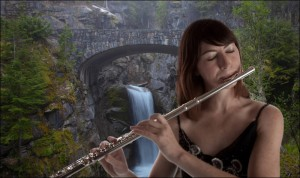 Woman playing a flute in front of a waterfall