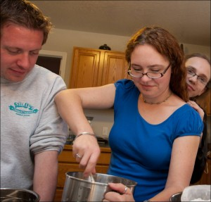 Three young people cooking together