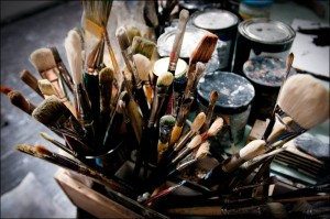 A jar full of paint brushes