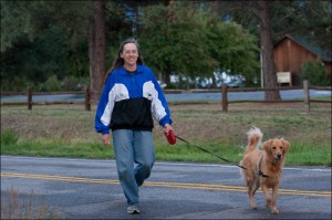 Marge walking down the road with her dog