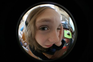 Distorted, fish-eye view of a teen